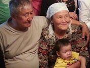Майра Саданова с мужем и внуком