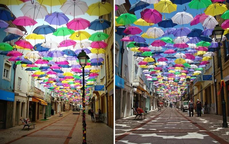 Эта традиция появилась 3 года назад и уже успела завоевать мировую славу. В городке Агуэда, в Португалии, на одной из улочек красуется необычная инсталляция Umbrella Sky, как часть фестиваля искусств Ágitagueda. Несколько десятков открытых цветных зонтов развешены здесь от одного дома до другого на тонких проволоках, и между ними почти нет просвета!