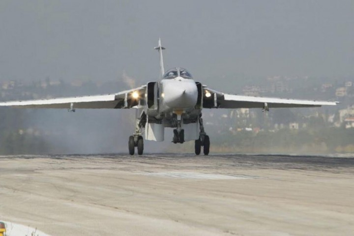 A Sukhoi Su-24 fighter jet lands at the Hmeymim air base near Latakia, Syria, in this handout photograph released by Russia's Defence Ministry November 7, 2015. REUTERS/Ministry of Defence of the Russian Federation/Handout via Reuters