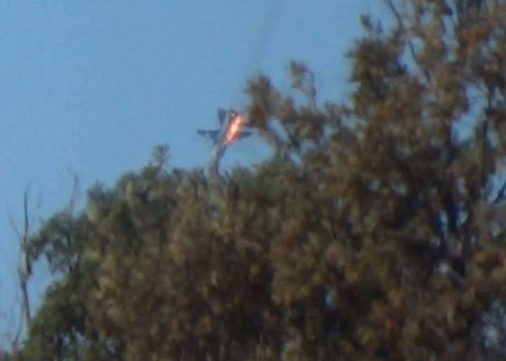 WARNING: GRAPHIC CONTENT - A war plane crashes in flames in a mountainous area in northern Syria after it was shot down by Turkish fighter jets near the Turkish-Syrian border November 24, 2015. Turkey shot down a Russian warplane near the Syrian border on Tuesday saying it had repeatedly violated its air space, one of the most serious publicly acknowledged clashes between a NATO member country and Russia for half a century. Moscow said it could prove the jet had not left Syrian air space. Turkish presidential sources said the warplane was a Russian-made SU-24. REUTERS/Sadettin Molla
