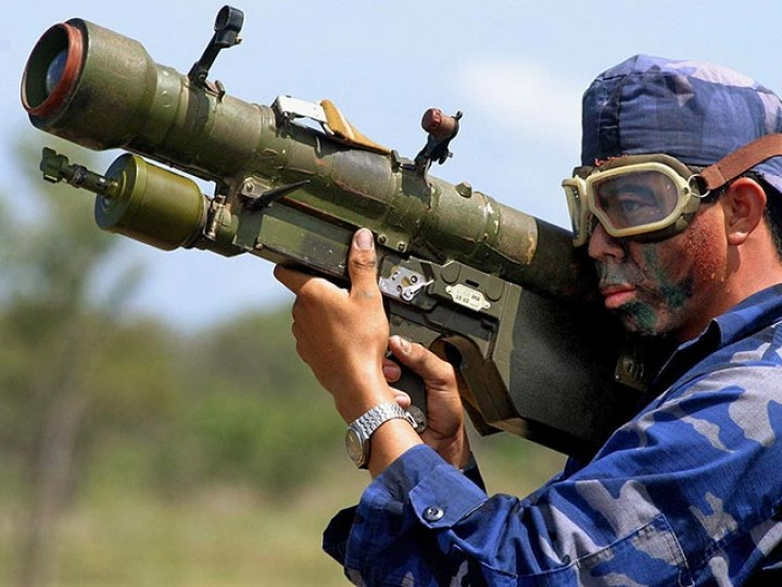 A member of the Nicaraguan Army prepares to use a SAM-7, during a military exercise on the national artillery range, some 58 miles west from Managua, on July 26, 2004. The Nicaraguan Army will destroy 333 land-air missiles CAP C2M, also known as the SAM 7, on July 28. The missiles were donated by the former Soviet Union. Nicaragua destroyed the first lot of 333 SAM 7 missiles in May to contribute to a balance of reasonable force in Central America. REUTERS/Oswaldo Rivas OR/JDP - RTR7H8Y