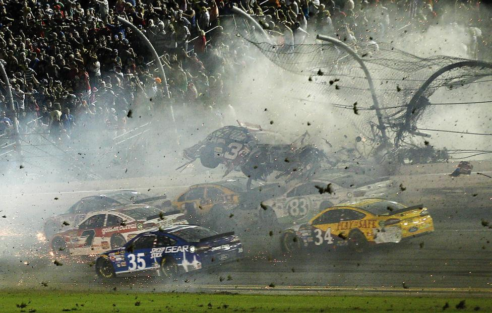 NASCAR Sprint Cup Series driver Austin Dillon car (3) crashes against the catch fence during the finish of the Coke Zero 400 at Daytona International Speedway, July 6, 2015. Reinhold Matay-USA TODAY Sports