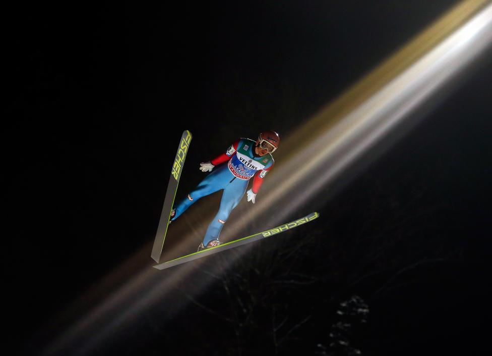 Stefan Kraft from Austria soars through the air during the first round for the final jumping of the 63rd four-hills Ski jumping tournament in Bischofshofen, Austria, January 6, 2015. REUTERS/Dominic Ebenbichler