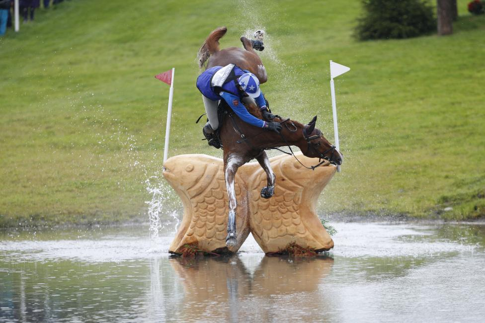 Russia's Mikhail Nastenko riding Reistag falls at the Lochan fence in the cross country event of FEI European Eventing Championship at Blair Castle, Scotland, Britain, September 12, 2015. REUTERS/Russell Cheyne