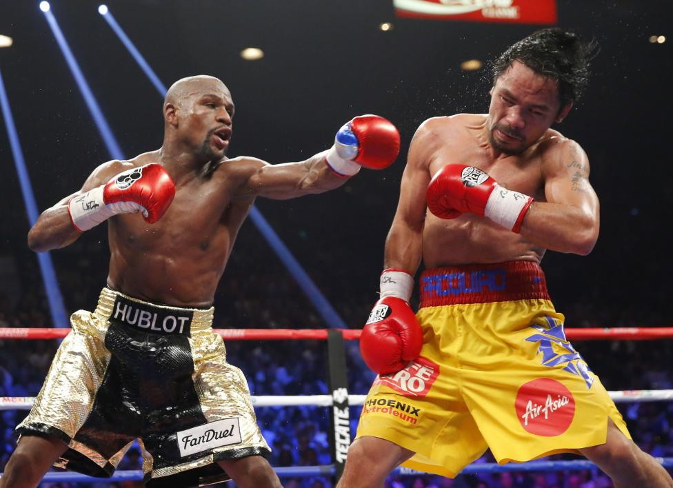 Floyd Mayweather, Jr. of the U.S. lands a left to the face of Manny Pacquiao of the Philippines in the 11th round during their welterweight WBO, WBC and WBA (Super) title fight in Las Vegas, May 2, 2015. REUTERS/Steve Marcus