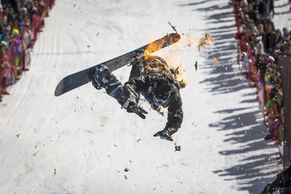A snowboarder performs during the Red Bull Jump and Freeze competition at ski resort Shimbulak outside Almaty, March 22, 2015. REUTERS/Shamil Zhumatov