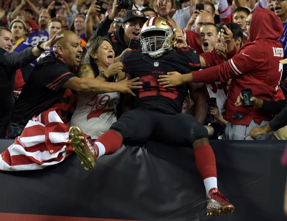 San Francisco 49ers running back Carlos Hyde celebrates with fans after scoring on a 10-yard touchdown run against the Minnesota Vikings in Santa Clara, September 14, 2015. Kirby Lee-USA TODAY Sports