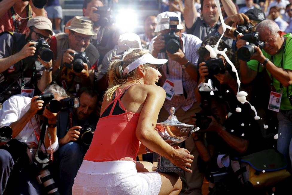 Maria Sharapova of Russia poses for photographers as she holds her trophy after winning the final match over Carla Suarez Navarro of Spain at the Rome Open tennis tournament in Rome, Italy, May 17, 2015. REUTERS/Stefano Rellandini