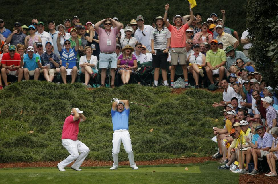 Padraig Harrington of Ireland reacts after missing a hole-in-one on the 9th tee with fellow countryman Shane Lowry (L) during the par 3 event held ahead of the 2015 Masters at Augusta National Golf Course in Augusta, April 8, 2015. REUTERS/Brian Snyder