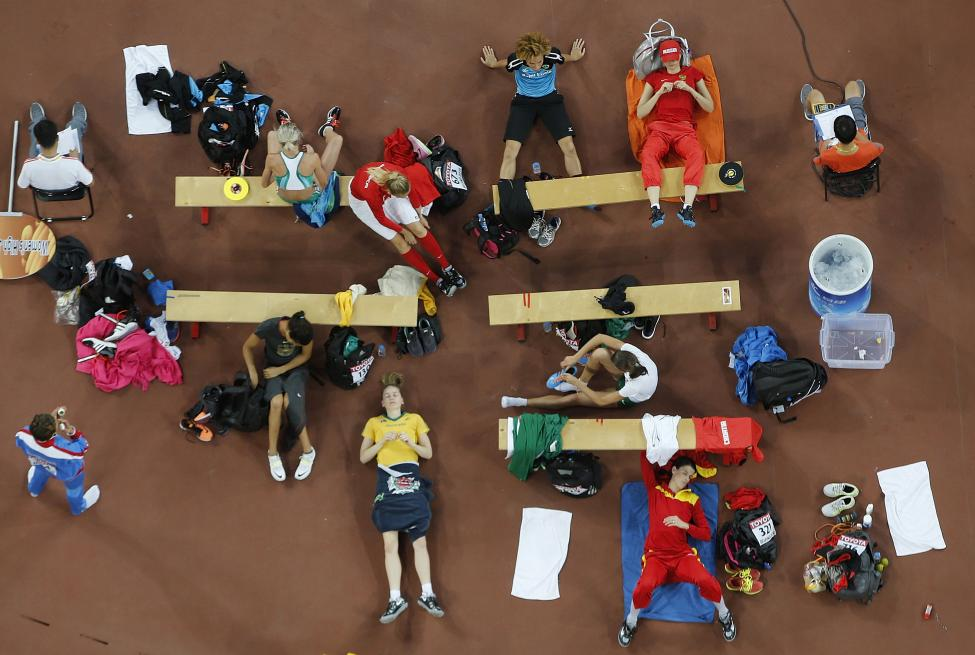 Athletes wait for their turns at the women's high jump final during the 15th IAAF World Championships at the National Stadium in Beijing, August 29, 2015. REUTERS/Fabrizio Bensch