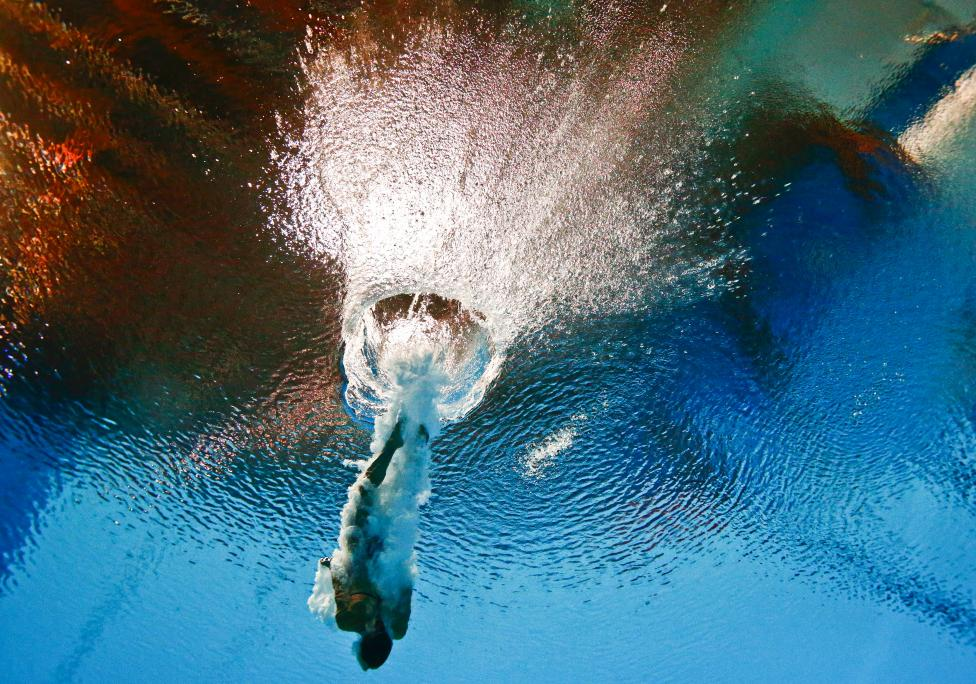 Tania Cagnotto of Italy is seen underwater during the women's 3m springboard semi final at the Aquatics World Championships in Kazan, Russia, July 31, 2015. REUTERS/Stefan Wermuth