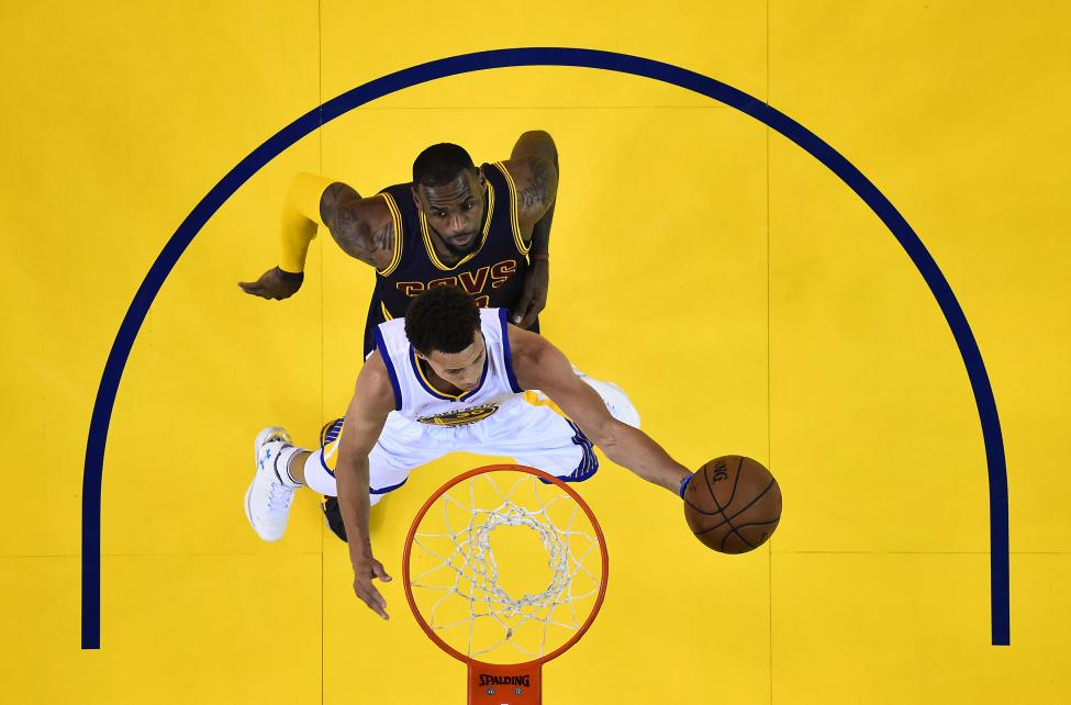 Golden State Warriors guard Stephen Curry shoots against Cleveland Cavaliers forward LeBron James in game five of the NBA Finals in Oakland, June 14, 2015. John G. Mabanglo-Pool Photo via USA TODAY Sports