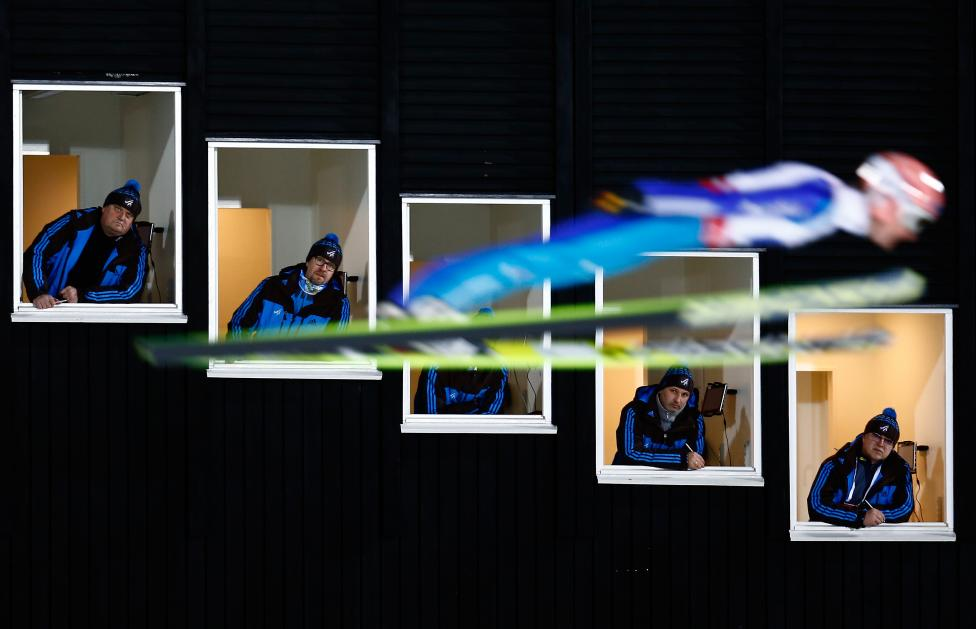 Severin Freund of Germany soars past judges windows during the normal hill HS100 mixed team ski jumping event of the Nordic World Ski Championships in Falun, Sweden, February 22, 2015. REUTERS/Kai Pfaffenbach