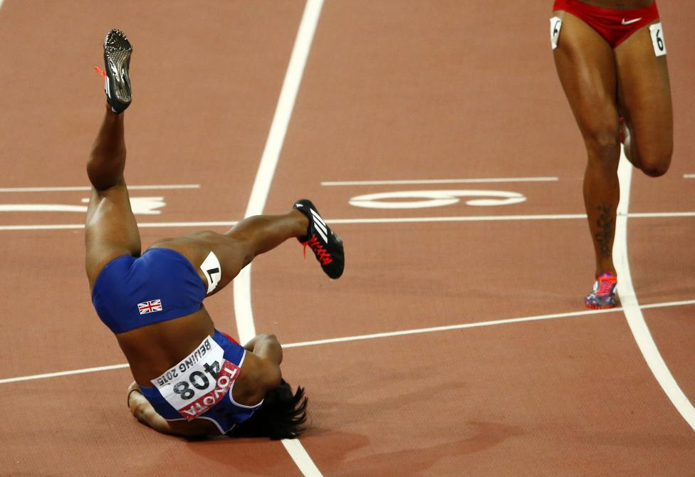 Tiffany Porter of Britain falls after competing in the women's 100 metres hurdles final during the 15th IAAF World Championships at the National Stadium in Beijing, August 28, 2015. REUTERS/David Gray
