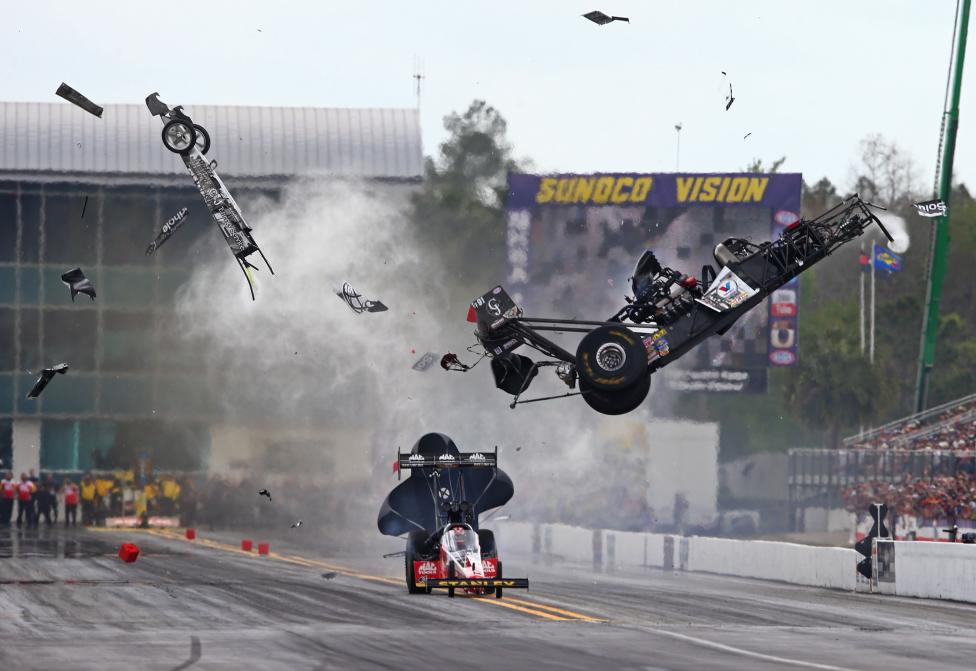 NHRA top fuel dragster driver Larry Dixon (right) crashes and goes airborne alongside Doug Kalitta after his car broke in half during qualifying for the Gatornationals at Auto Plus Raceway at Gainesville, Florida, March 14, 2015. Dixon walked away from the incident, Mark J. Rebilas-USA TODAY Sports