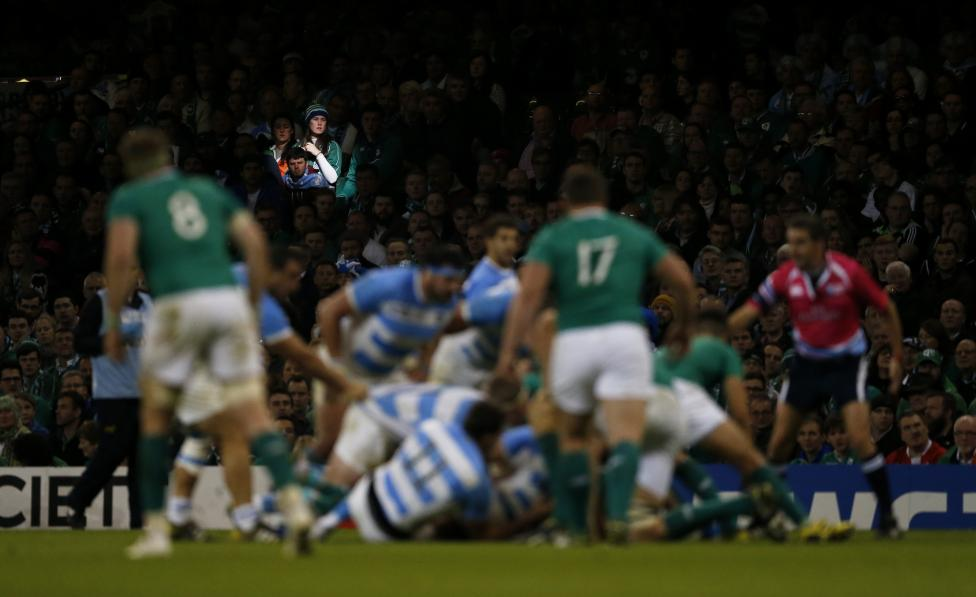 Fans watch the action as Ireland plays Argentina during the Rugby World Cup in Cardiff, Wales, October 18, 2015. Action Images via Reuters / Andrew Boyers
