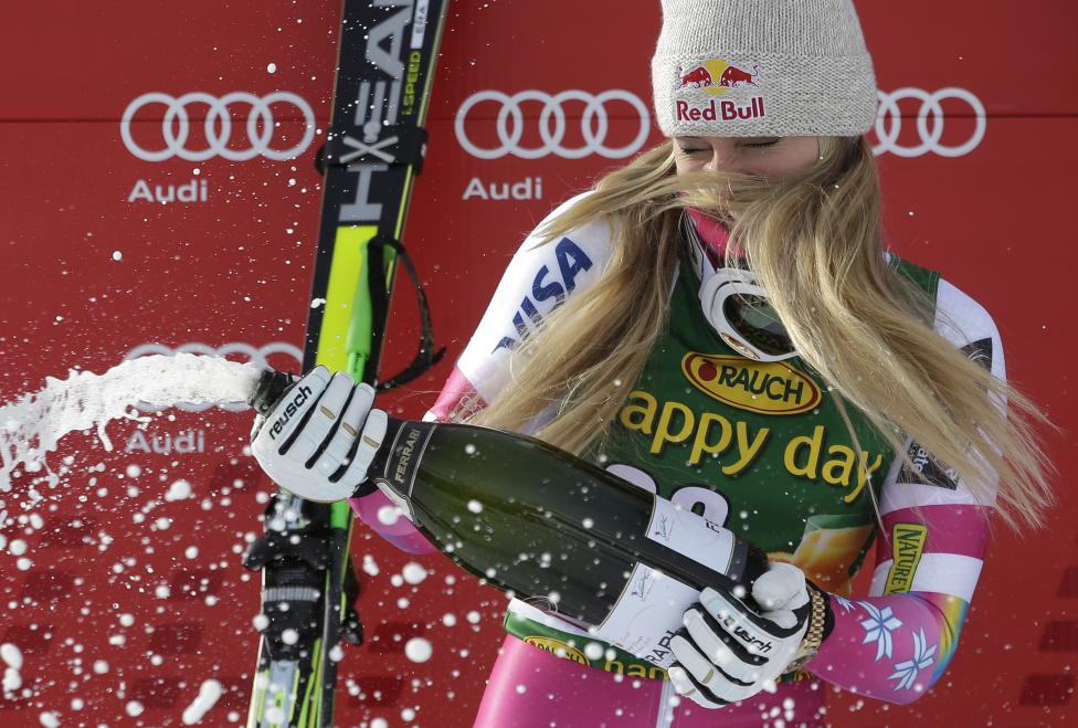 Lindsey Vonn of the U.S. sprays champagne on the podium after winning the women's World Cup Super-G skiing race in Cortina D'Ampezzo, January 19, 2015. Vonn became the most successful female in Alpine skiing World Cup history when she won the Super-G, her 63rd victory in the competition. REUTERS/Max Rossi