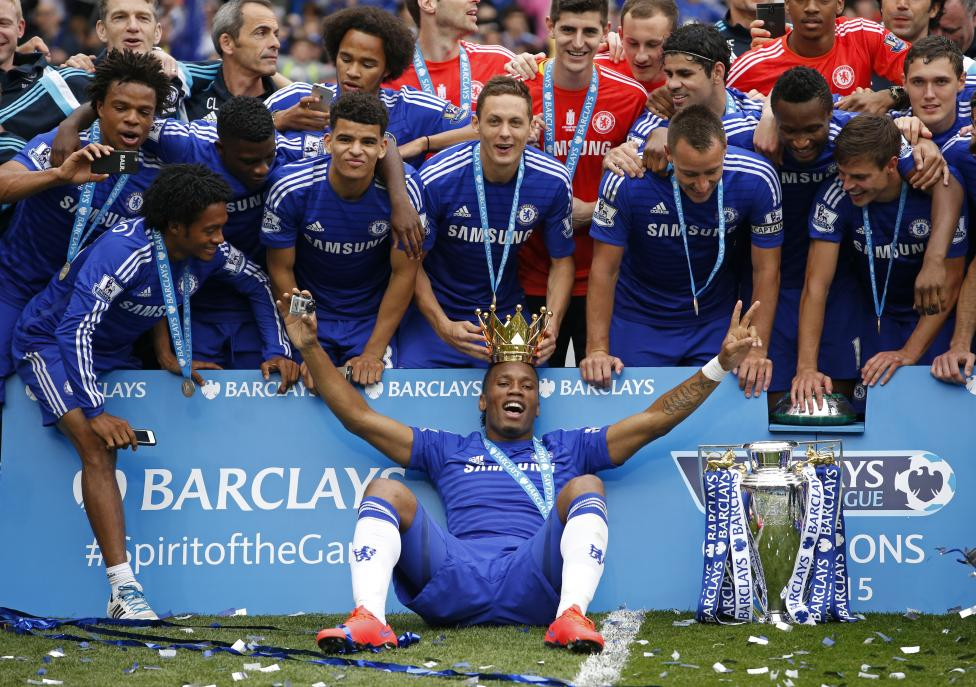 Chelsea players celebrate with the trophy after winning the Barclays Premier League at Stamford Bridge, May 24, 2015. Action Images via Reuters / John Sibley Livepic