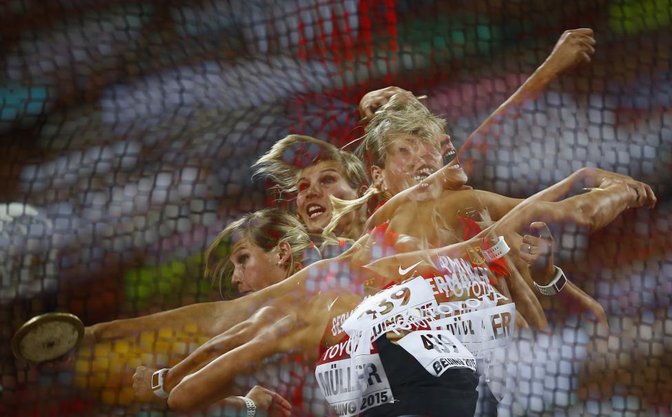 Nadine Mueller of Germany competes to win bronze in the women's discus throw final during the 15th IAAF World Championships at the National Stadium in Beijing, August 25, 2015. REUTERS/Kai Pfaffenbach