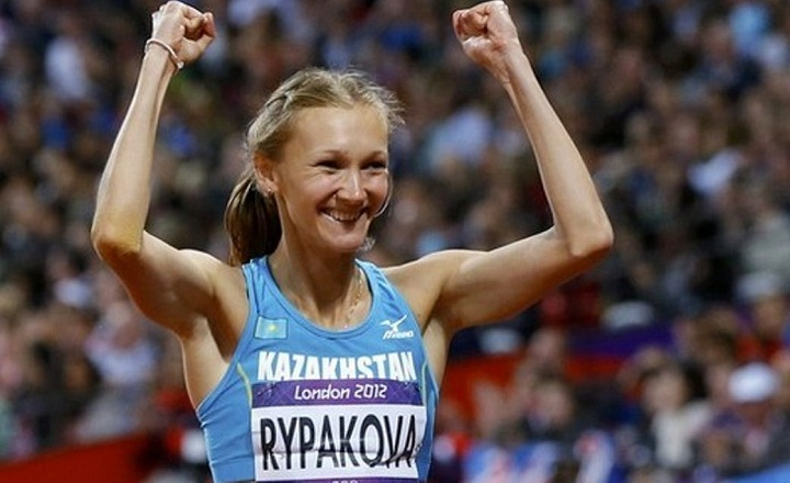 Kazakhstan's Olga Rypakova reacts after winning in the women's triple jump final during the London 2012 Olympic Games at the Olympic Stadium August 5, 2012. REUTERS/Phil Noble (BRITAIN - Tags: SPORT ATHLETICS OLYMPICS)