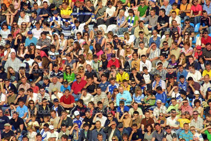People seat on a stadium tribune