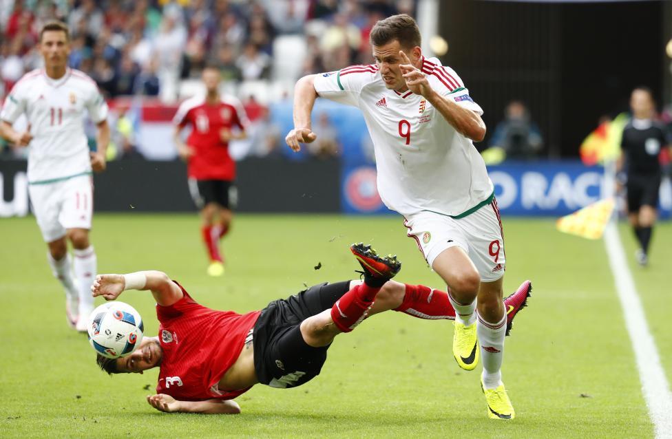 Austria's Aleksandar Dragovic fouls Hungary's Adam Szalai. REUTERS/Michael Dalder Livepic