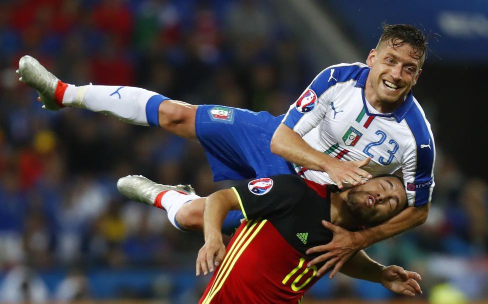 Italy's Emanuele Giaccherini in action with Belgium's Eden Hazard. REUTERS/Kai Pfaffenbach Livepic