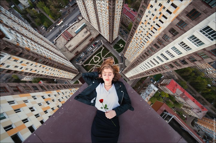 Moscow. VERTIGO inducing pictures from the top of a 155-foot-high crane have been captured by a photographer in bid to overcome his fear of heights. The amazing aerial images show the photographer and his friends throw caution to the wind as they precariously perch high above the cities with no safety equipment. Other shots capture the adventurous bunch in the middle of climbs up cranes and beautiful women posing on the edge of roof tops. The extreme photos were taken by Moscow photographer and acrophobic George Lanchevsky (24) in cities around the world including Moscow, Galich and Hong Kong.