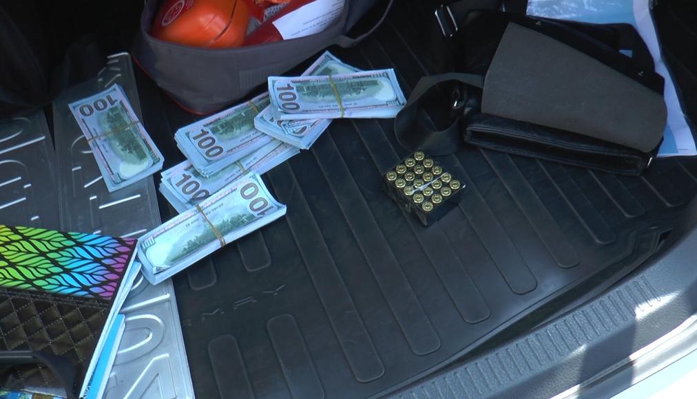 Оружие, пачки долларов и стробоскопы: в Алматы остановлен подозрительный водитель